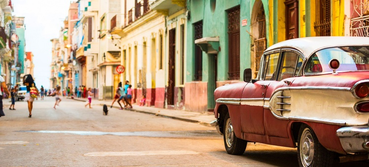 Street in Havana at Cuba with vintage american car